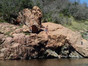 Cliff jumpers at Devil's Waterhole